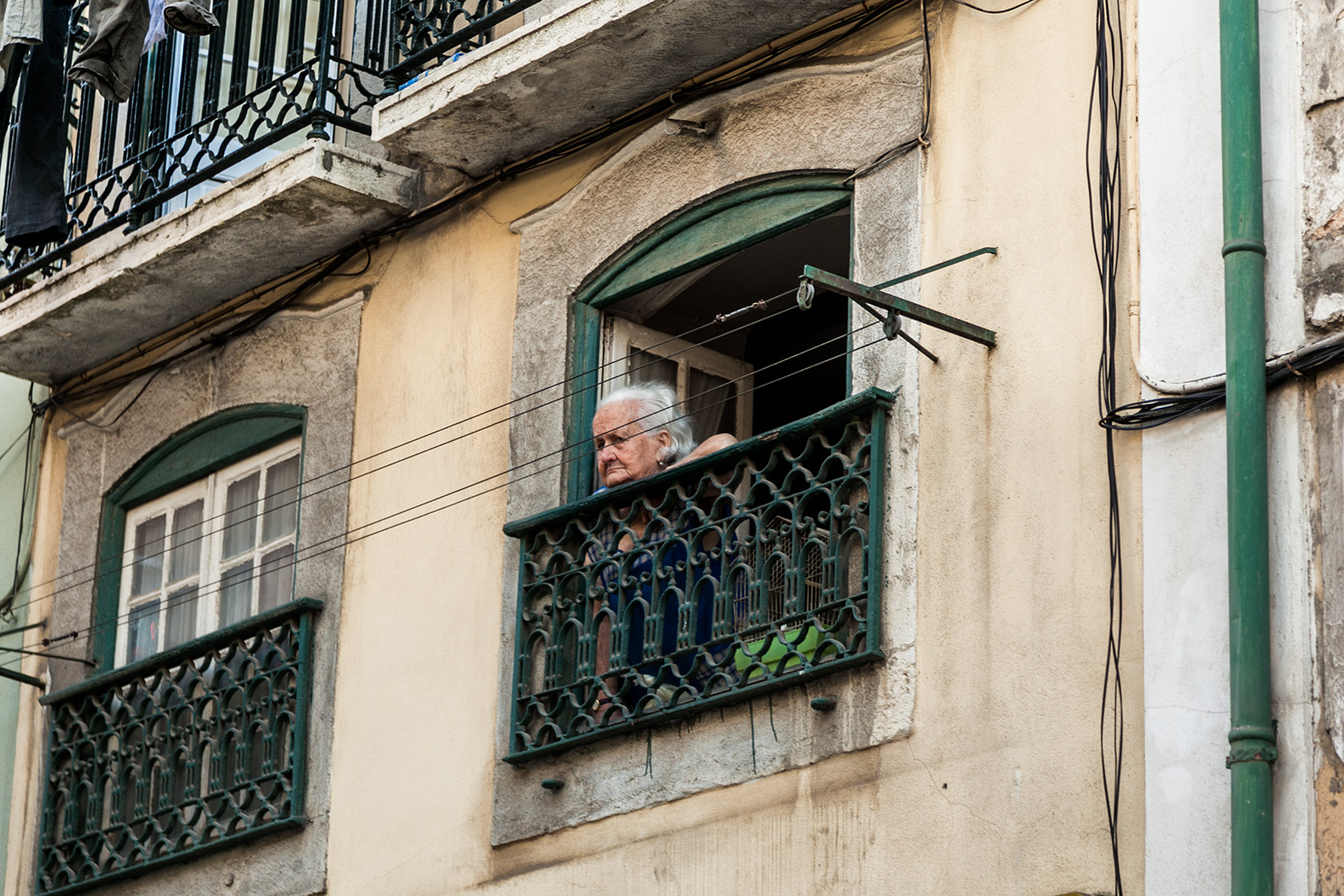 Overlooking the street. An old lady